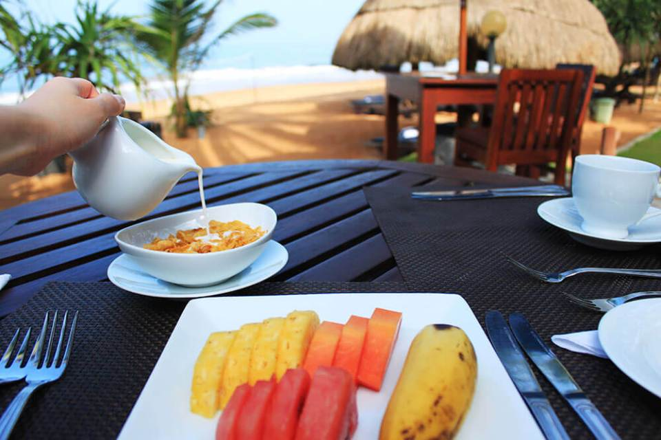 healthy breakfast fruits milk cereal by the beach private sea rock villa bentota sri lanka agirlnamedclara