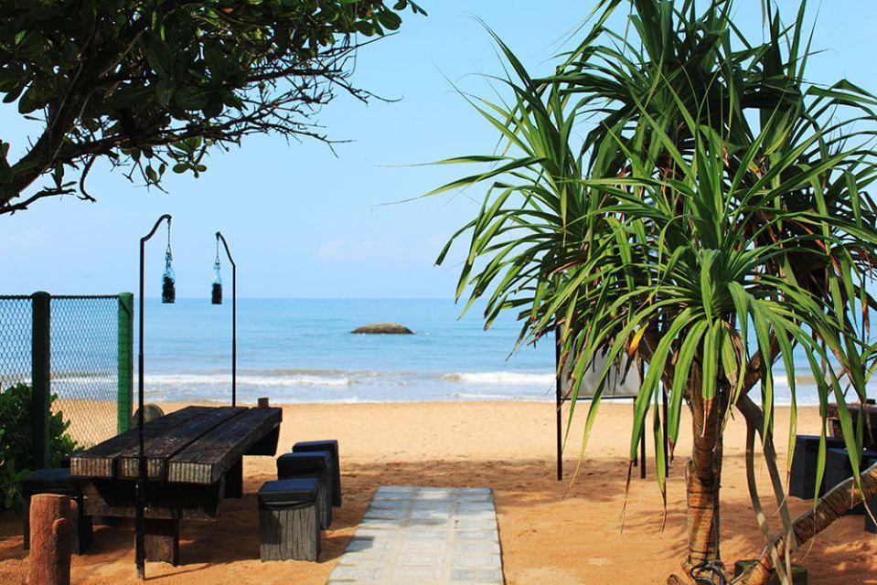 morning wooden table blue sky bentota beach sri lanka no people agirlnamedclara