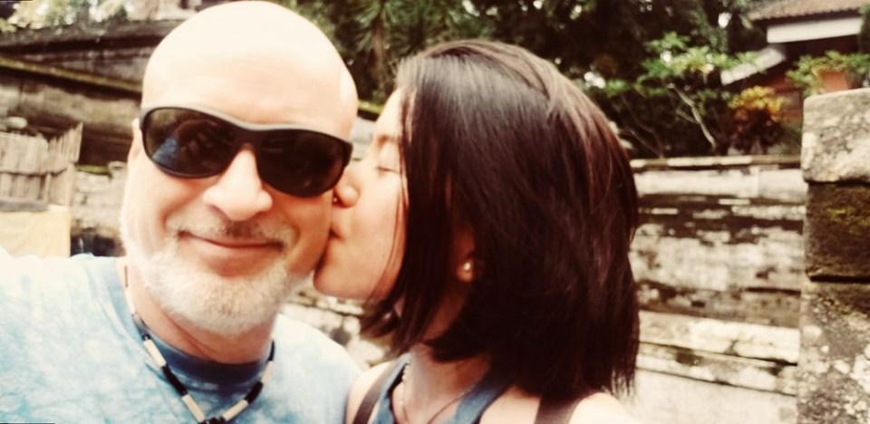 young girl kissing older boyrfriend bali goa gajah happy love couple agirlnamedclara