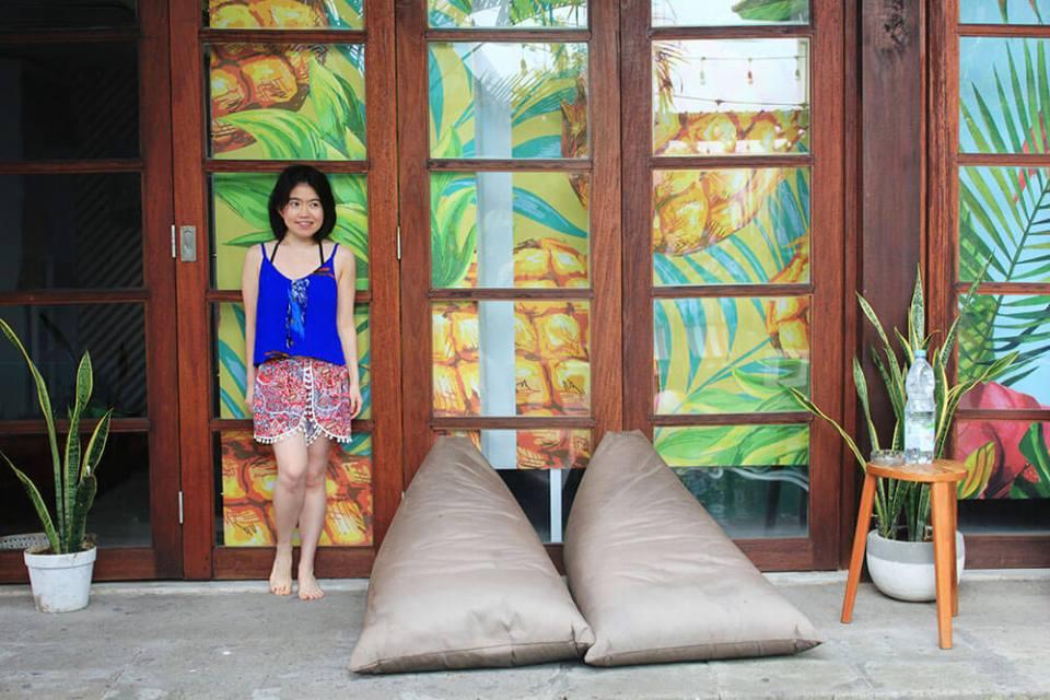 confucio room socialista lifestyle hostel seminyak bali guide to choosing a hostel girl beach suit pineapple wallpaper beanbags agirlnamedclara