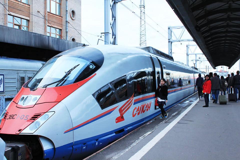 asian girl in black dress ready to board bullet train st petersburg moscow russia agirlnamedclara