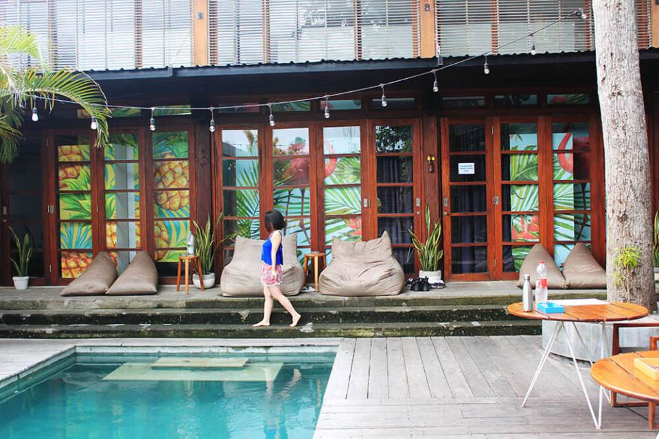 asian girl short hair walking beside a pool seminyak bali socialista lifestyle hostel agirlnamedclara