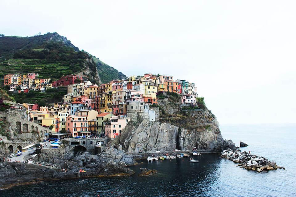 cinque terre italy colourful houses on cliff agirlnamedclara