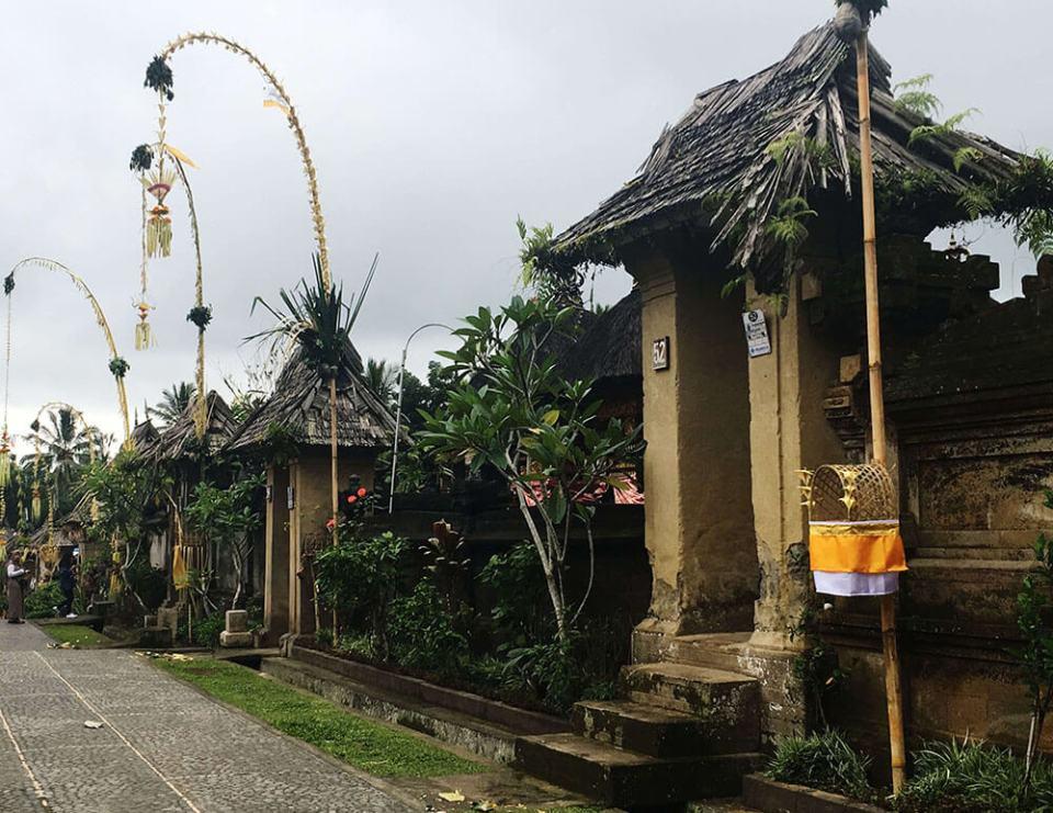 house gate in penglipuran bali during galungan festival agirlnamedclara