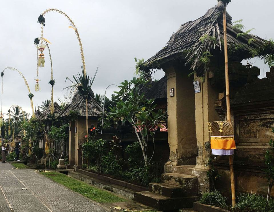 house gate in penglipuran bali during galungan festival agirlnamedclara