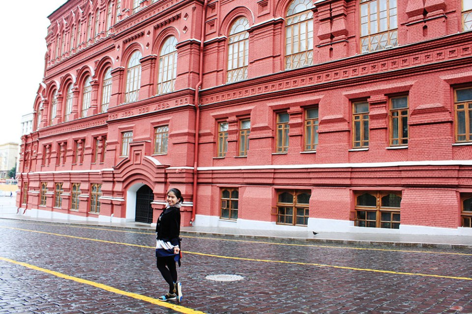 red square building moscow russia background a girl stand in the middle of the road rainy day agirlnamedclara