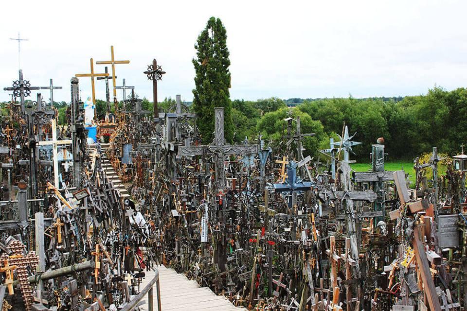 hundreds of thousands of cross Hill of Cross Lithuania blue sky garden background_agirlnamedclara