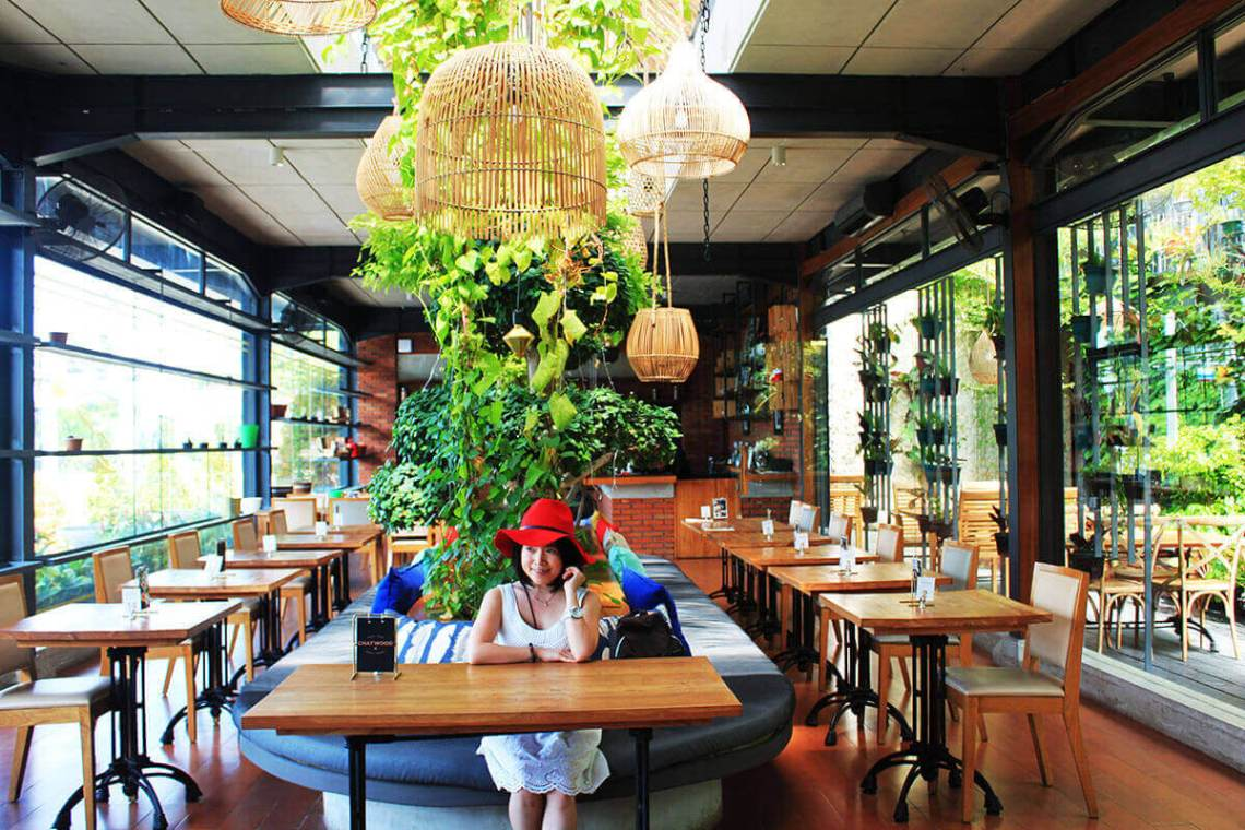 miracle covid19 asian girl smiling red hat white dress sitting looking outside cafe eco green design_agirlnamedclara