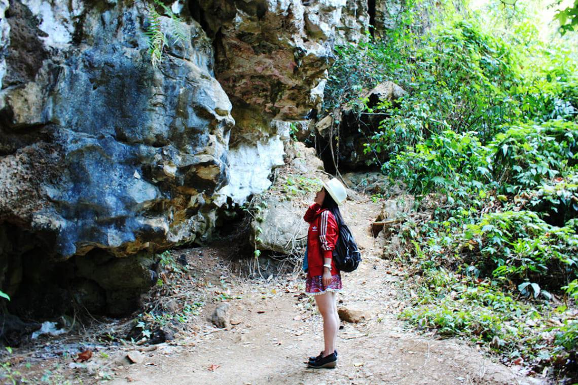 girl traveler look at gua kingkong karst stone bukit rammang rammang makassar indonesia travel_agirlnamedclara