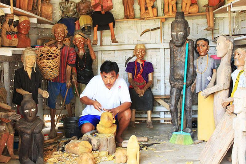local craftman carving tau tau wooden dolls in londa toraja trip_agirlnamedclara