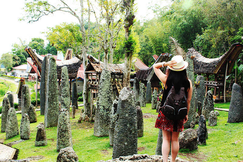 ancient megalith burial site bori toraja girl traveler look in awe_agirlnamedclara