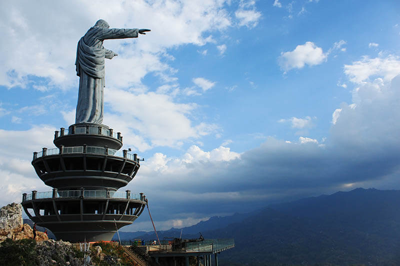 jesus christ the redeemer statue burake hills makale bird eye view blue sky background_agirlnamedclara