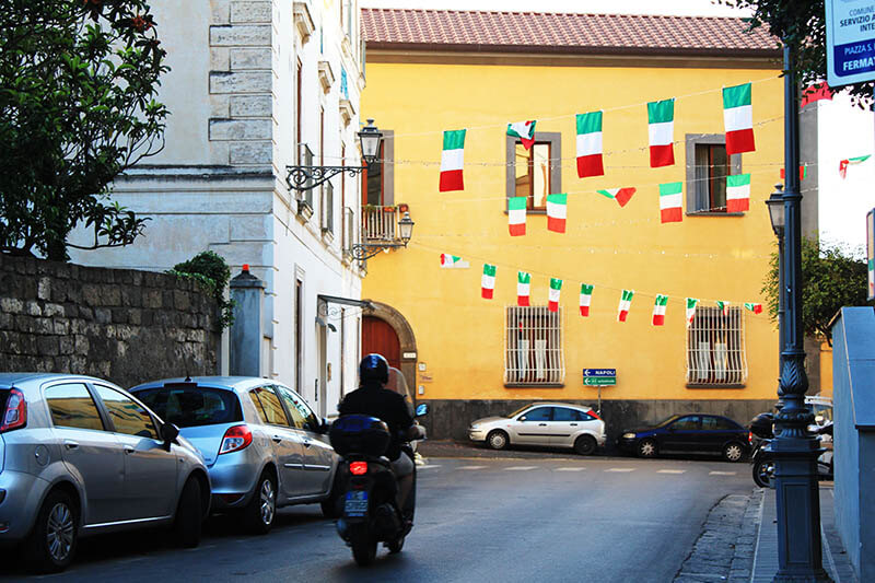 scooter sorrento italy yellow buildings italian flag agirlnamedclara