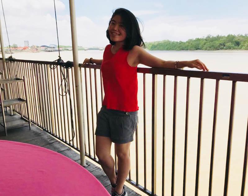 asian girl short hair smile river background jeti seafood restaurant kuala selangor agirlnamedclara