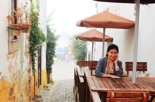 asian girl sit smiling mist morning obidos portugal agirlnamedclara