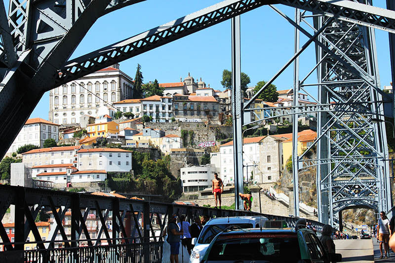 boy walking on the bridge porto portugal agirlnamedclara