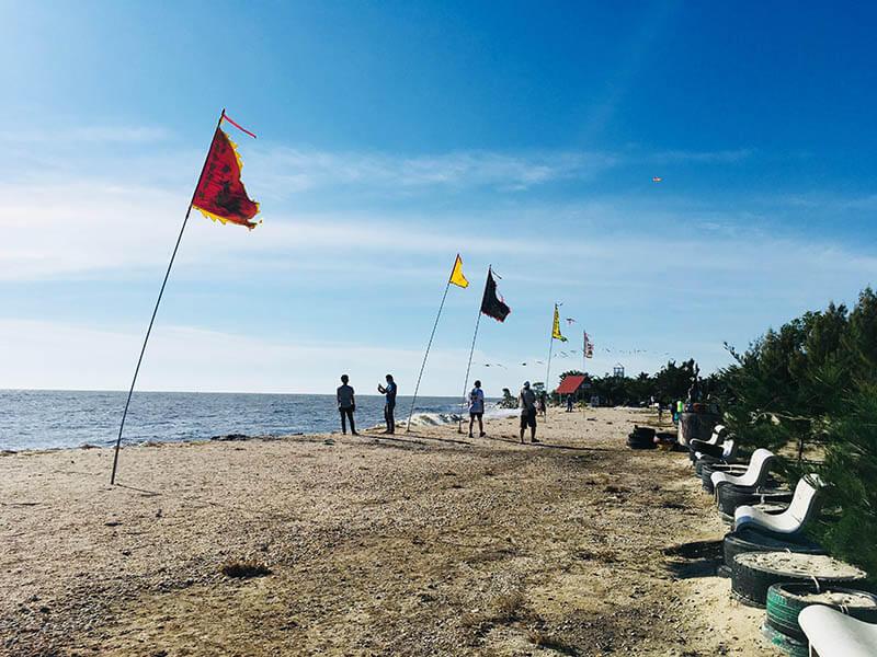 pantai redang beach white sand blue sky colofrul flags agirlnamedclara