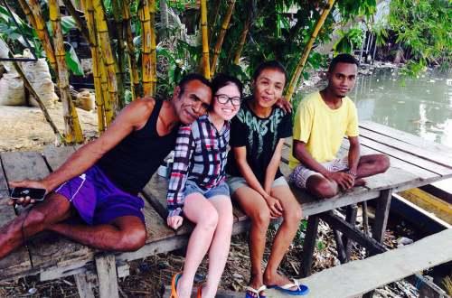 asian girl tourist with local people sorong raja ampat indonesia agirlnamedclara sit river