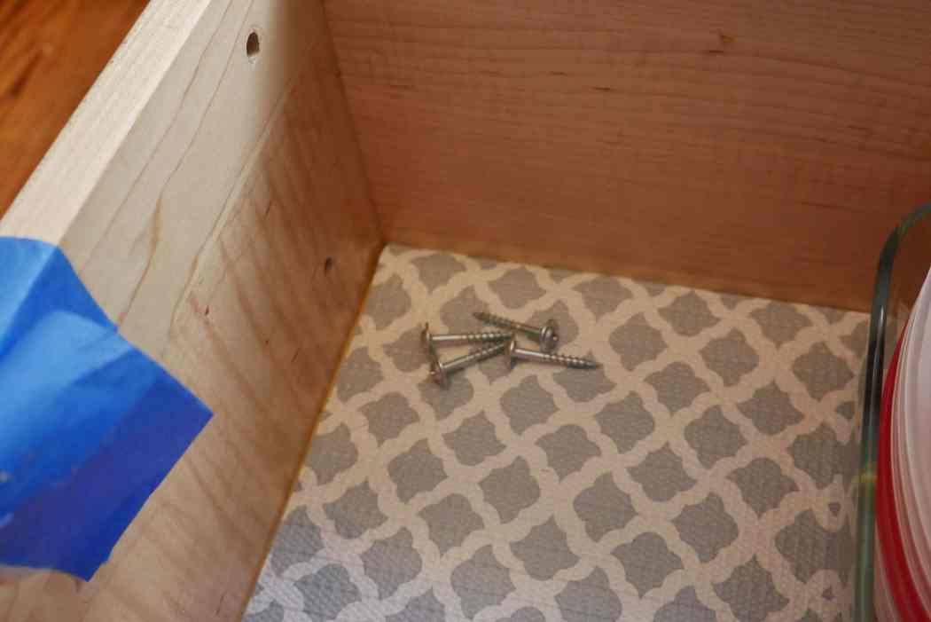 screws inside cabinet drawer