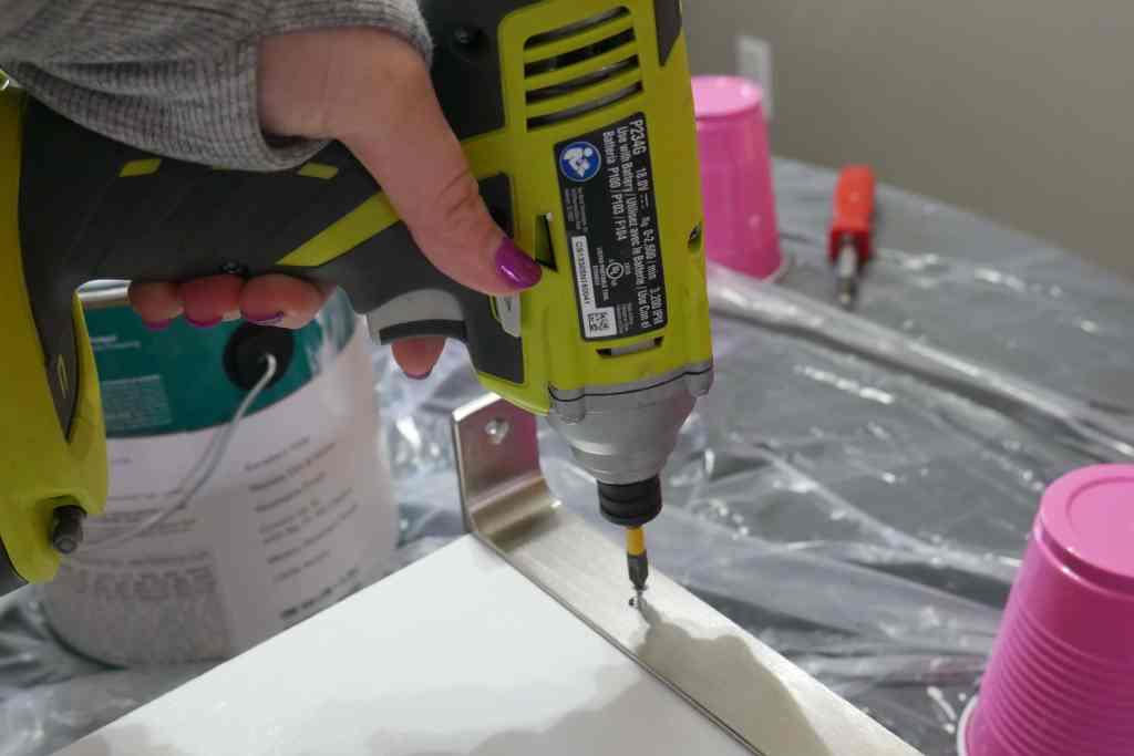 using drill to install bracket