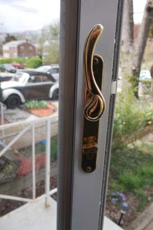 storm door handle locked