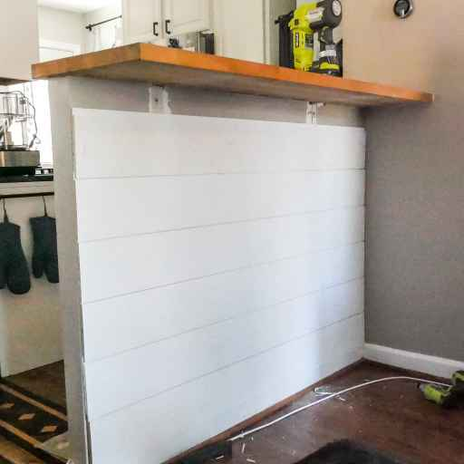 mostly completed shiplapped breakfast bar