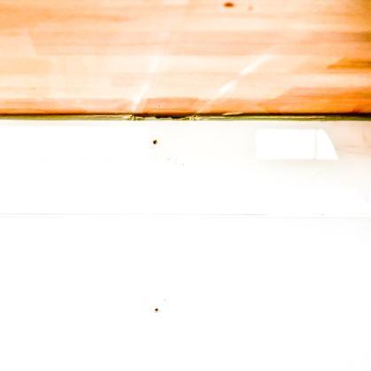 gap between the shiplap wall and butcher block countertop