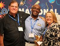 Carl Cushnie receiving Outstanding  Educator award from Ken Dowling and Nancy Kinard