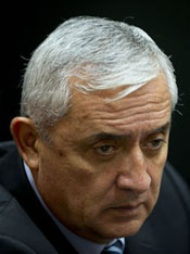 Guatemala's former president Otto Perez Molina attends a third hearing on corruption allegations that led him to resign, in Guatemala City, Tuesday, Sept. 8, 2015. The court is considering allegations that Perez Molina was involved in a scheme in which businesspeople paid bribes to avoid import duties through Guatemala's customs agency. (AP Photo/Moises Castillo)