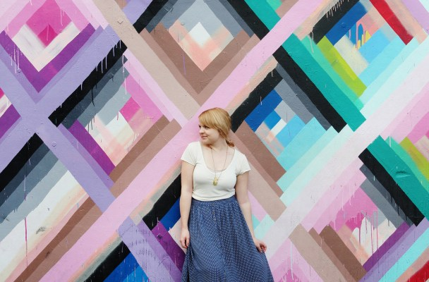 Artistic tips for posing with murals in your travel photos