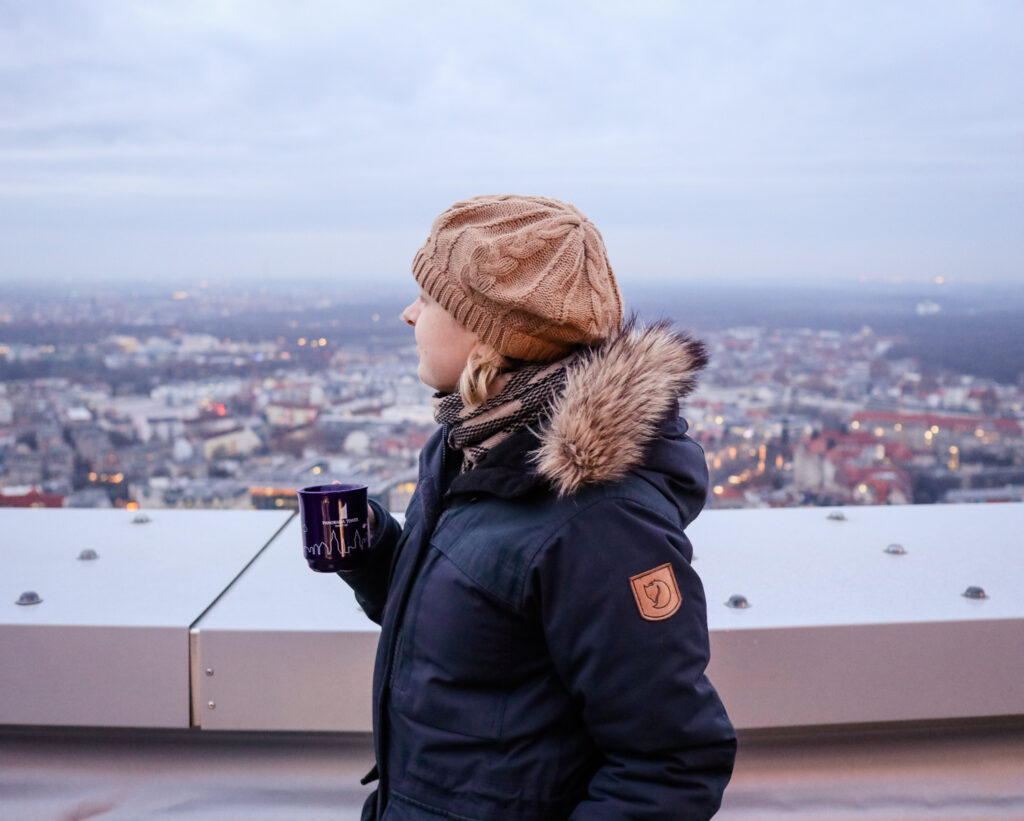 Drinking gluhwein at the Panorama Tower observation deck in Leipzig