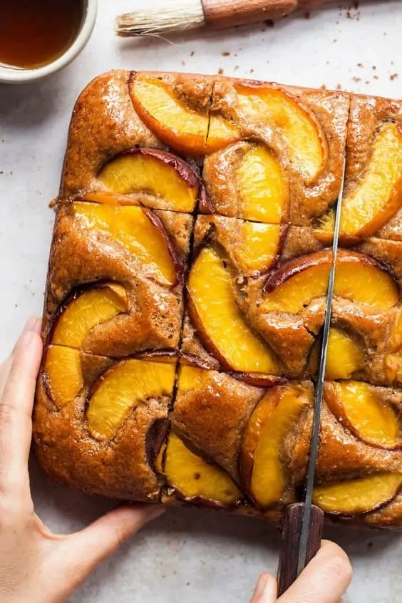 Vegan almond loaf cake, topped with nectarines.