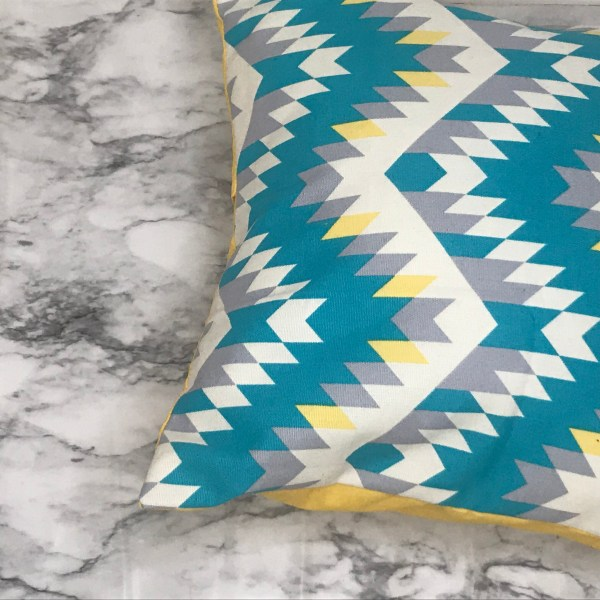 African print pillow - blue and yellow