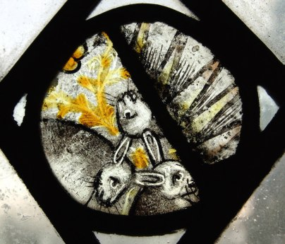 The 'Three Hares' roundel. Three ears are visible yet each hare has two ears! Painted glass, Holy Trinity, Long Melford.