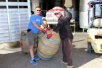 Atwater FFA Advisor Dave Gossman and Inglenook Winery's Amabassador harold Francis load up empty wine barrels that will be provided to the Atwater High School Agriculture Department for student FFA shop projects
