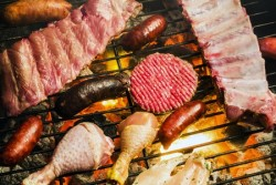 Assorted meat on barbecue grill