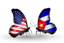 Two butterflies with flags on wings as symbol of relations USA and Cuba