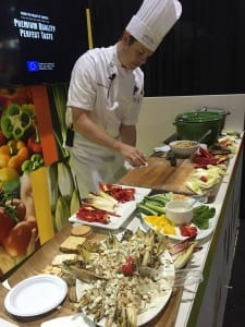 A chef cooks up creations at PMA Fresh Summit