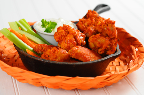 chicken wings and fresh vegetables.