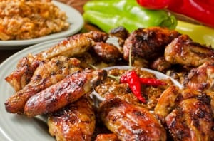 A plate of barbequed chicken wings.