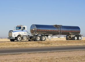 Stainless steel milk hauling trailer transporting milk from the farm.