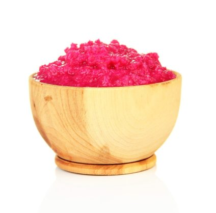 Horseradish sauce with beet in wooden bowl
