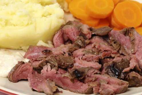 """""""London broil"""" marinaded flank of beef steak grilled and sliced thinly, then served with mashed potato, boiled sliced carrots and horseradish sauce"""