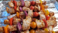 fish kebabs with cherry tomatoes bell pepper and onion
