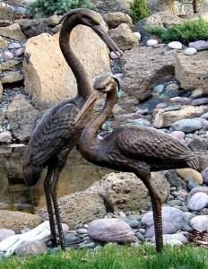 Heron statues