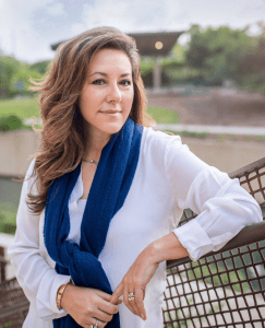 Digital marketing consultant, Aurora Geis, stands against fence in San Antonio