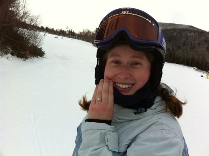 Meghan with engagement ring on a ski slope