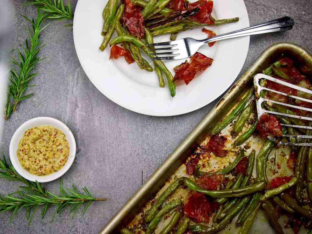 plate of crispy green beans with prosciutto and mustard