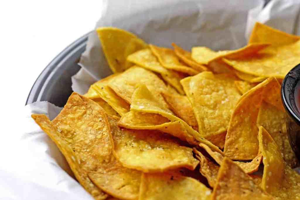 Close up of a basket of air fryer tortilla chips