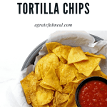 "Overview of basket of chips with salsa with the text ""air fryer tortilla chips"""